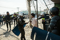 03 January, 2014 - Phnom Penh. A man pleads with police after a raid inside Veng Sreng market. © Thomas Cristofoletti / Ruom 2014