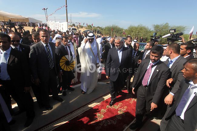 Palestinian Prime Minister in Gaza strip,  Ismail Haniyeh and the Emir of Qatar Sheikh Hamad bin Khalifa al-Thani attend a cornerstone laying ceremony for Hamad, a new residential neighbourhood in Khan Younis in the southern Gaza Strip October 23, 2012. The Emir of Qatar entered the Gaza Strip on Tuesday for a visit that broke the isolation of it Islamist rulers, Hamas, but disappointed Israel and mainstream Palestinian leaders in the West Bank. Photo by Ashraf Amra