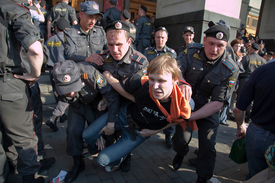 Moscow, Russia, 31/05/2010..Police arrest demonstrators as they break up an opposition protest in central Moscow and arrest around 170 people. Opposition activists hold regular demonstrations on the 31st day of the month, protesting against restrictions on the freedom of assembly, which is protected by article number 31 of the Russian constitution.