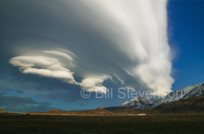 A lenticular cloud at sunset over the Sierra mountains.