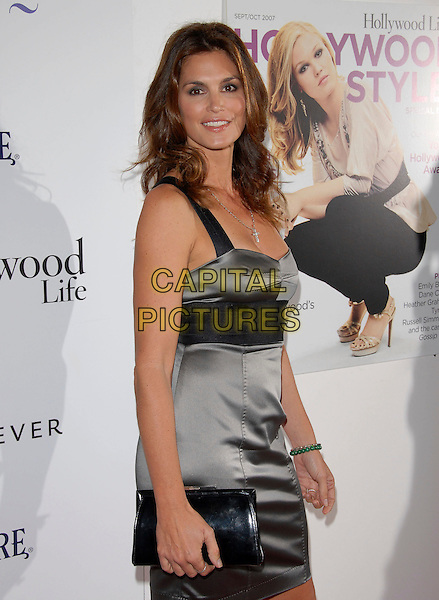 CINDY CRAWFORD.attends The 4th Annual Hollywood Style Awards held at Th ePacific Design Center in Beverly Hills, California, USA, October 07 2007.   .half length grey gray dress black waistband straps clutch bag.CAP/DVS.©Debbie VanStory/Capital Pictures