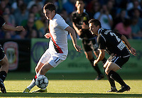 Manchester City midfielder Adam Johnson dribbles past Portland Timbers midfielder Derek Gaudet during a match at Merlo Field in Portland Oregon on July 17, 2010.
