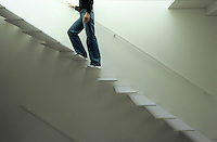 The cantilevered stairs are made of white painted metal to maximise the natural light