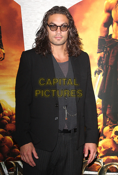 Jason Momoa at the European Premiere of 'Conan the Barbarian 3D' at the O2 Arena, London, England..August 14th 2011.half length black jacket tinted glasses sunglasses shades pinstripe grey gray waistcoat.CAP/ROS.©Steve Ross/Capital Pictures
