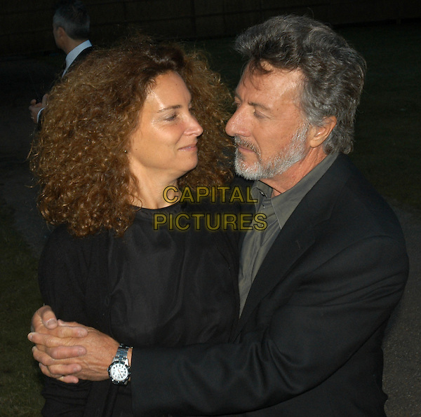DUSTIN HOFFMAN & wife.Serpentine Gallery summer party, Hyde Park, London, .9th July 2002..half length.Ref:PL.© Capital Pictures.sales@capitalpictures.com.www.capitalpictures.com.