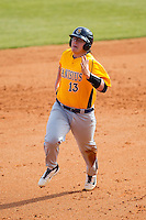 Christ Conley (13) of the Canisius Golden Griffins hustles towards third base against the Charlotte 49ers at Hayes Stadium on February 23, 2014 in Charlotte, North Carolina.  The Golden Griffins defeated the 49ers 10-1.  (Brian Westerholt/Four Seam Images)