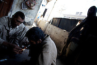 A community of heroin addicts share a few doses of heroin on the second floor of a depot in front of a Mosque  in the city of Rawalpindi, Pakistan on Thursday November 27 2008.///..While Bangladesh, India, Nepal and Maldives all suffer from drug consumption, Pakistan is the worst victim of the drug trade in South Asia. Today, the country has the largest heroin consumer market in the south-west Asia region..The drug addicts resort to crime for generating income for the purchase of narcotics. The situation is becoming serious due to the number of heroin addicts in the country. An alarming rate of increase of 100,000 addicts per year is highly dangerous to society. The drug addicts are affecting nearly 20 million dependents and family members with psychological, social, and economic repercussions.