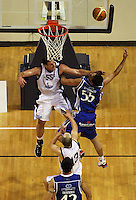 Giants centre Chris Reay tries to block Troy McLean during the NBL Round 2 basketball match between the Wellington Saints and Nelson Giants at TSB Bank Arena, Wellington, New Zealand on Thursday 19 March 2009. Photo: Dave Lintott / lintottphoto.co.nz