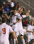 14 December 2007: Ohio State's Eric Brunner (23) and Massachusetts' Kenny Cook (behind) challenge for a header. The Ohio State University Buckeyes defeated the University of Massachusetts Minutemen 1-0 at SAS Stadium in Cary, North Carolina in a NCAA Division I Mens College Cup semifinal game.