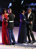 United States President Barack Obama and first lady Michelle Obama dance with members of the U.S. armed forces during the Commander-In-Chief Ball at the Walter Washington Convention Center January 21, 2013 in Washington, DC. President Obama started his second term by taking the Oath of Office earlier in the day during a ceremony on the West Front of the U.S. Capitol..Credit: Chip Somodevilla / Pool via CNP