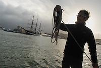 - boat leaving the port of Livorno, in the background the Palinuro school  ship of Italian Navy....- barca in uscita dal porto di Livorno, sullo sfondo la nave scuola Palinuro della Marina Militare Italiana