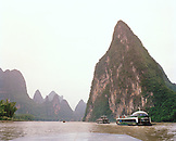 CHINA, Guilin, boats on the Li River with Limestone mountains in the background
