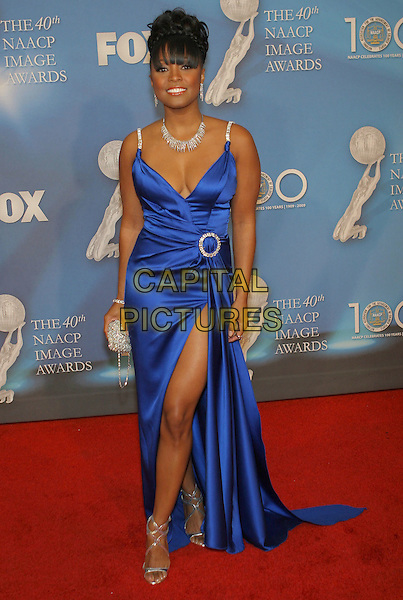 KESHIA KNIGHT PULLMAN.40th Annual NAACP Image Awards held at the Shrine Auditorium, Los Angeles, California, USA..February 12th, 2009.full length long maxi slit split blue silk satin dress cleavage silver clutch bag buckle.CAP/ADM/TC.©T. Conrad/AdMedia/Capital Pictures.