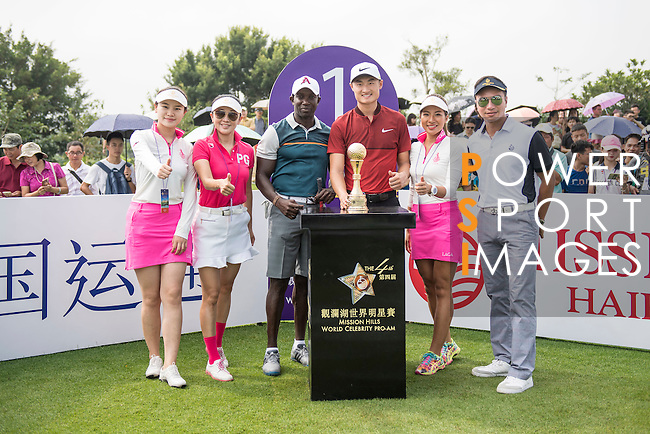 (L-R) Two unidentified women, Dwight Yorke, Li Haotong, one unidentified woman, Tenniel Chu at the 1st hole during the World Celebrity Pro-Am 2016 Mission Hills China Golf Tournament on 23 October 2016, in Haikou, China. Photo by Weixiang Lim / Power Sport Images