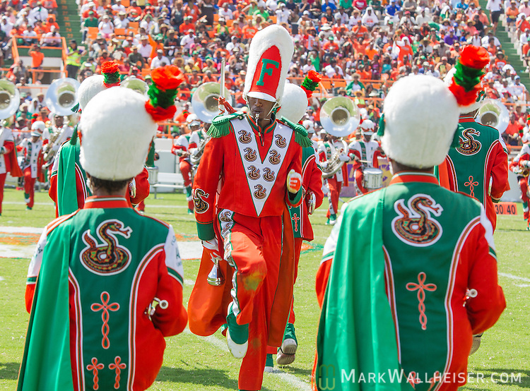 TALLAHASSEE, FL - SEPTEMBER 7, 2013:   <br /> The FAMU Marching 100 band halftime performance on the field when the Florida A&amp;M Rattlers played the Tennessee State Tigers in NCAA football.   The temperature was 110 degrees on the filed.