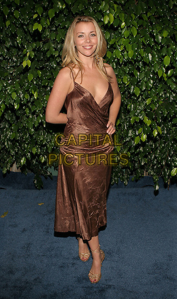 CHRISTIE CLARK.The 'Days of Our Lives' 40th Anniversary party. Los Angeles, California..USA, United States..11th November 2005.Ref:ADM/ZL.full length brown silk satin dress plunging neckline hand on hip smiling posed.www.capitalpictures.com.sales@capitalpictures.com.© Capital Pictures.