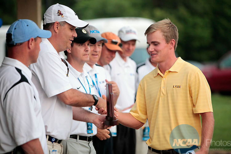 02 JUNE 2011:  John Peterson of Louisiana State University receives his championship trophy following the Division I Men's Golf Championship held at the Karsten Creek Golf Course in Stillwater,OK.  Peterson won the individual national title with a -5 score.  Shane Bevel/NCAA Photos