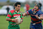 Waiuku fullback O. Latatasi  is about to be tackled by T. Luteru. Counties Manukau Premier Club Rugby, Ardmore Marist vs Waiuku played at Bruce Pulman Park, Papakura on the 29th of April 2006. Ardmore Marist won 10 - 9.