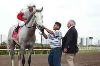 Hit It Rich with Javier Castellano up gets congratulated by trainer Shug McGaughey (right) after winning the Orchid Stakes (G3T). Gulfstream Park Hallandale Beach Florida. 03-31-2012. Arron Haggart / Eclipse Sportswire