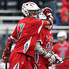 Steven Pinto #17 of Connetquot, left, celebrates with Tyler Cordes #26 after a goal in a Suffolk County varsity boys lacrosse game against host Huntington High School on Friday, April 7, 2017. Pinto netted four goals, including three in the fourth quarter, to rally Connetquot from a 12-10 deficit in the final period to a 15-14 win.