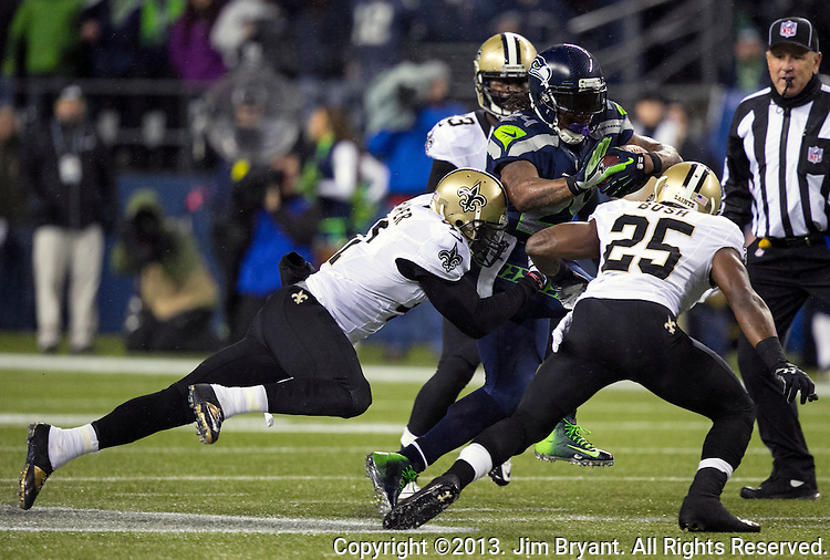 Seattle Seahawks running back Marshawn Lynch (24) carries New Orleans Saints on his way to a 15 yard gain during the second quarter at CenturyLink Field in Seattle, Washington on December 2, 2013.The Seahawks beat the Saints 34-7 to take the best record team in the NFL.©2013. Jim Bryant Photo. ALL RIGHTS RESERVED.