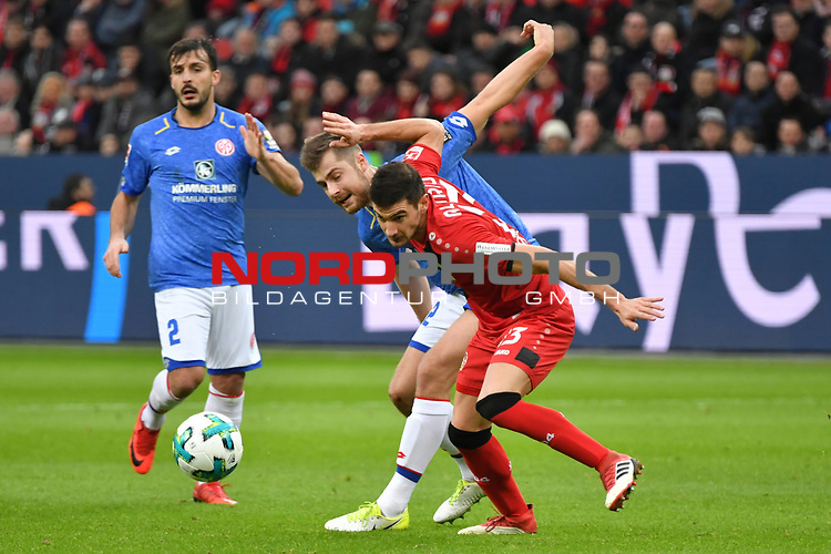 28.01.2018, BayArena, Leverkusen , GER, 1.FBL., Bayer 04 Leverkusen vs. 1. FSV Mainz 05<br /> im Bild / picture shows: <br /> Lucas Alario (Leverkusen #13),  Alexander Hack (Mainz 05 #42),  li Giulio Donati (Mainz 05 #2), <br /> <br /> <br /> Foto &copy; nordphoto / Meuter