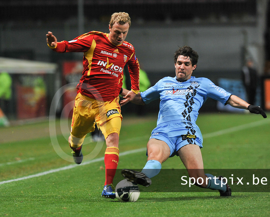 20111202 - LENS , FRANCE : RC Lens'  DAVID POLLET (left) pictured during the soccer match between Racing Club de LENS and TOURS , on the sixteenth matchday in the French Ligue 2 at the Stade Bollaert Delelis stadium , Lens . Friday 2 December 2011 . PHOTO DAVID CATRY