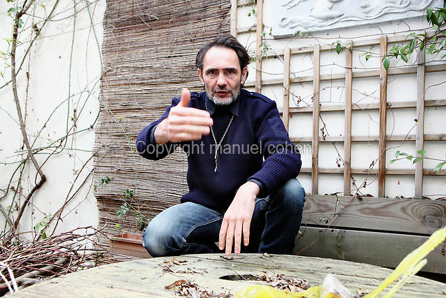 Kasper (b.1962), French sculptor and painter, in the garden of his Parisian studio, on March 10, 2012, Asnieres, Hauts-de-Seine, France. Trained at lAcademie du Jeudi (1970-1975), a free expression studio directed by Arno Stern,  then until 1984 at E.N.S.A.A.M.A. (Ecole Nationale Superieure des Arts Appliques et Metiers dArt), and finally he studied sculpture in stone at  the Ateliers de la Glaciere (1996-99).  Since 2000 Kasper has created many monumental statues with  mythological equestrian, marine and animal themes which are situated  throughout France and as far afield as China, the USA and the Middle East. Picture by Manuel Cohen