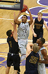 SIOUX FALLS, SD - JANUARY 2:  James Lawson #32 from the University of Sioux Falls shoots over Austin Saugstad #1 from Augustana in the first half of their game Friday night at the Stewart Center. (Photo by Dave Eggen/Inertia)