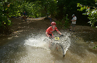 NWA Democrat-Gazette/BEN GOFF @NWABENGOFF<br /> August Bailey, a category 1 racer from Fayetteville, fords a creek Sunday, July 16, 2017, during cross country races on the final day of the 19th annual Fat Tire Festival at Lake Leatherwood City Park in Eureka Springs.