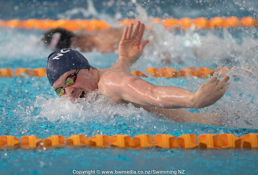 Jeremy Tasker winning the Final of the Men 100SC meter Butterfly, at the New Zealand Short Course Swimming Championships, National Aquatic Centre, Auckland, New Zealand, Friday 4th October 2019. Photo: Brett Phibbs/www.bwmedia.co.nz/SwimmingNZ