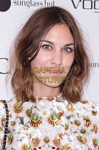 Alexa Chung.Alexa Chung attends 2nd Annual Capsule Collection For Vogue Eyewear Launch, New York City, NY, USA..September 24th, 2011.headshot portrait white pink green yellow print floral.CAP/ADM/CS.©Christopher Smith/AdMedia/Capital Pictures.