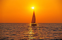Sailing on Lake Ontario at sunset<br /> Ste Catharines<br /> Ontario<br /> Canada