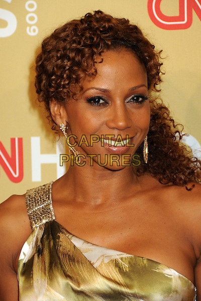 HOLLY ROBINSON PEETE .CNN Heroes: An All-Star Tribute 2009 held at the Kodak Theatre, Hollywood, California, USA,.21st November 2009 .portrait headshot one shoulder print gold earrings curly hair side ponytail .CAP/ADM/BP.©Byron Purvis/AdMedia/Capital Pictures.