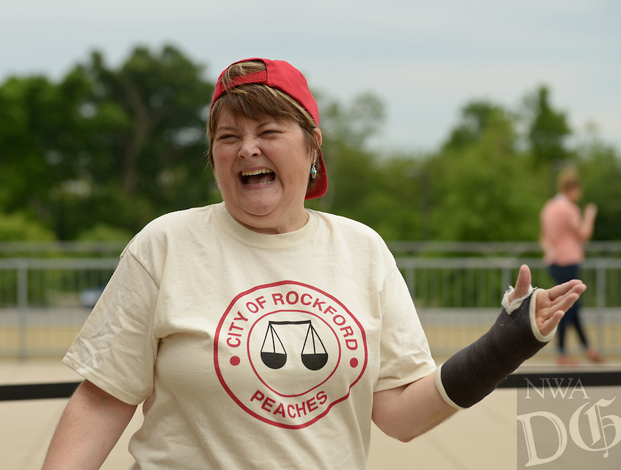 NWA Democrat-Gazette/BEN GOFF @NWABENGOFF<br /> Megan Cavanagh, who played Marla Hooch, talks to the press on Sunday May 8, 2016 before the 2nd annual Bentonville Film Festival 'A League of Their Own' reunion softball game at Arvest Ballpark in Springdale.