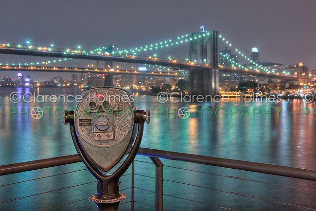 View from South Street Seaport of Brooklyn and Manhattan bridges on the East River at night