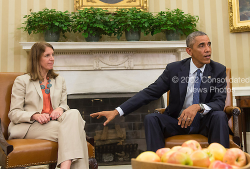 United States President Barack Obama speaks alongside Sylvia Burwell , Secretary of Health and Human Services, as he addresses the media following a meeting with his team coordinating the government's Ebola response, in the Oval Office at the White House in Washington, D.C. on October 16, 2014. Others at the meeting included, Denis McDonough, White House Chief of Staff,  Susan Rice, National Security Advisor, Lisa Monaco, Assistant to the President for Homeland Security and Counterterrorism and Dr. Thomas Frieden, Director of the Centers for Disease Control and Prevention. <br /> Credit: Kevin Dietsch / Pool via CNP