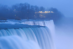 The American Falls on a rainy, foggy winter evening at Niagara Falls, New York State, USA