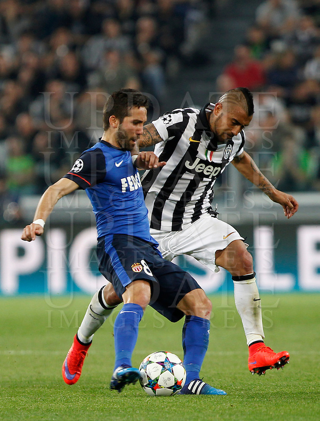 Calcio, quarti di finale di andata di Champions League: Juventus vs Monaco. Torino, Juventus stadium, 14 aprile 2015.<br /> Monaco's Joao Moutinho, left, is challenged by Juventus' Arturo Vidal during the Champions League quarterfinals first leg football match between Juventus and Monaco at Juventus stadium, 14 April 2015.<br /> UPDATE IMAGES PRESS/Isabella Bonotto