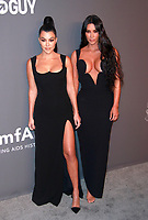 NEW YORK, NY - FEBRUARY 6: Kourtney Kardashian and Kim Kardashian West arriving at the 21st annual amfAR Gala New York benefit for AIDS research during New York Fashion Week at Cipriani Wall Street in New York City on February 6, 2019. <br /> CAP/MPI99<br /> ©MPI99/Capital Pictures