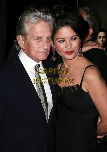 MICHAEL DOUGLAS & CATHERINE ZETA JONES.Premiere of 'Wall Street: Money Never Sleeps' at the Ziegfeld Theatre on September 20, 2010 in New York City, New York, NY, USA..September 20th, 2010.half length suit jacket black white dress white shirt married husband wife navy blue.CAP/ADM/PZ.©Paul Zimmerman/AdMedia/Capital Pictures.