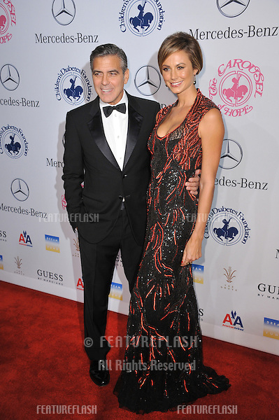 George Clooney & Stacy Keibler at the 26th Carousel of Hope Gala at the Beverly Hilton Hotel..October 20, 2012  Beverly Hills, CA.Picture: Paul Smith / Featureflash