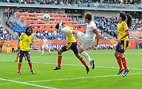 Abby Wambach (r) of team USA and Kelis Peduzine of team Columbia during the FIFA Women's World Cup at the FIFA Stadium in Sinsheim, Germany on July 2nd, 2011.