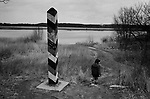 A boy walking past a pillar marking the border between the former East Germany and Poland on the river Oder at Frankfurt-an-der-Oder, after the fall of the Berlin Wall. The Berlin Wall was a barrier constructed by the German Democratic Republic (GDR, East Germany) starting on 13 August 1961, that completely cut off West Berlin from surrounding East Germany and from East Berlin. The Wall was opened on 9. November 1989 allowing free movement of people from east to west.