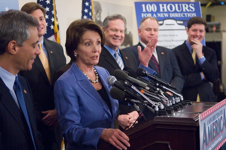 "01/18/07--DCCC Chairman Rahm Emanuel, D-Ill., House Speaker Nancy Pelosi, D-Calif., and other House Democrats during a news conference on the completion of the first 100 legislative hours of the 110th Congress. They touted their ""100 Hours for a New Direction,"" citing the passage of an ethics package; fiscal legislation; implementation of 9/11 Commission recommendations; an increase in the minimum wage; legislation allowing the expansion of stem cell research; negotiation for prescription drugs; lower interest rates on student loans; and energy legislation. Congressional Quarterly Photo by Scott J. Ferrell"