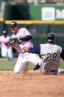 May 10, 2009:  Second Baseman Matt Macri of the Rochester Red Wings, Triple-A International League affiliate of the Minnesota Twins, comes up with an arrant throw getting a force out at second during a game at Frontier Field in Rochester, NY.  The Red Wings wore special pink jerseys for Mothers Day.  Photo by:  Mike Janes/Four Seam Images