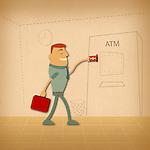 Man using an ATM