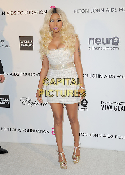 Nicki Minaj.The 21st Annual Elton John AIDS Foundation Academy Awards Viewing Party held at The City of West Hollywood Park in West Hollywood, California, USA..February 24th, 2013.oscars full length silver white strapless dress cleavage gold shoes platform   .CAP/DVS.©DVS/Capital Pictures.