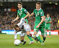 08/10/2015; UEFA Euro 2016 Group D Qualifier - Republic of Ireland v Germany, Aviva Stadium, Dublin. <br /> Germany's Mario Gotze with James McCarthy of Ireland<br /> Picture credit: Tommy Grealy/actionshots.ie.