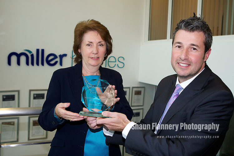 Pix: Shaun Flannery/shaunflanneryphotography.com...COPYRIGHT PICTURE>>SHAUN FLANNERY>01302-570814>>07778315553>>..26th October 2010...............Miller Homes Yorkshire..Retiring sales adviser Carol Durand pictured with Sales Director Steve McElroy.